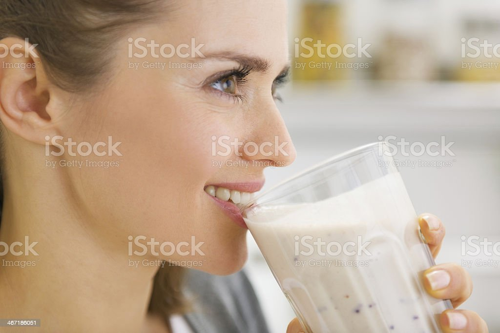 happy young woman drinking cocktail stock photo