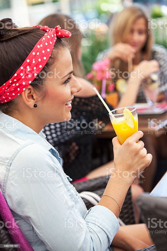 Happy Young Woman Drinking Orange Juice royalty-free stock photo