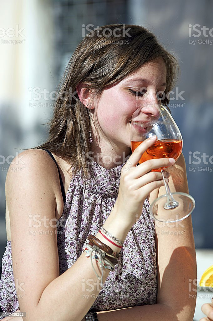 Happy Young Woman Drinking royalty-free stock photo