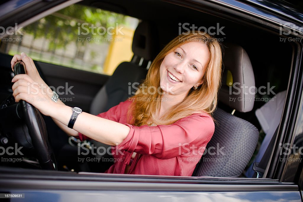 Happy Young Woman Driving car royalty-free stock photo