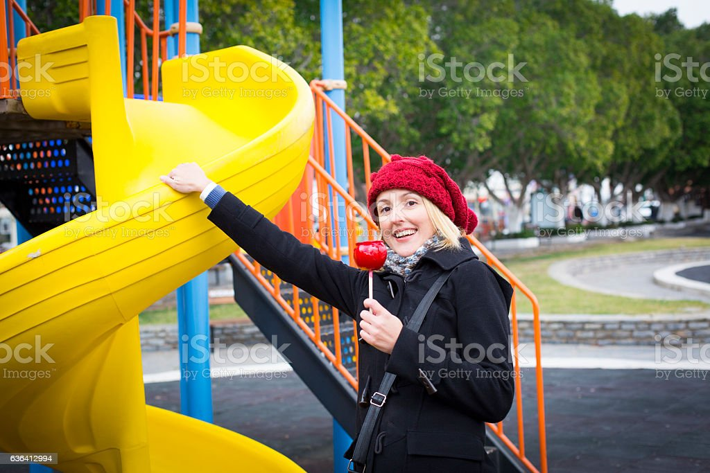 Happy young woman feels like a child stock photo