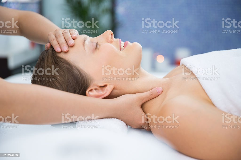 Happy Young Woman Getting Spa Treatment in Salon stock photo