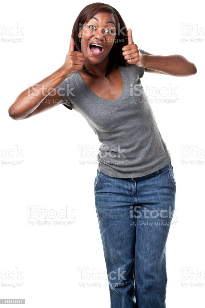 Happy young woman giving two thumbs up royalty-free stock photo
