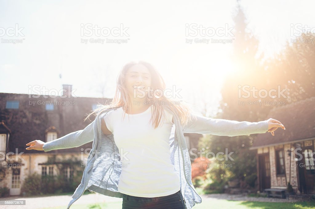 Happy young woman having fun outdoors stock photo