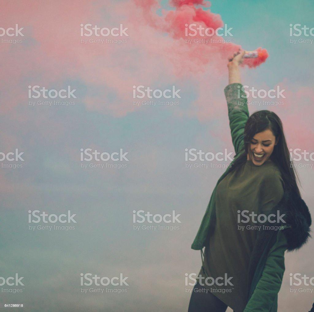Happy Young Woman Having Fun With smoke bomb stock photo