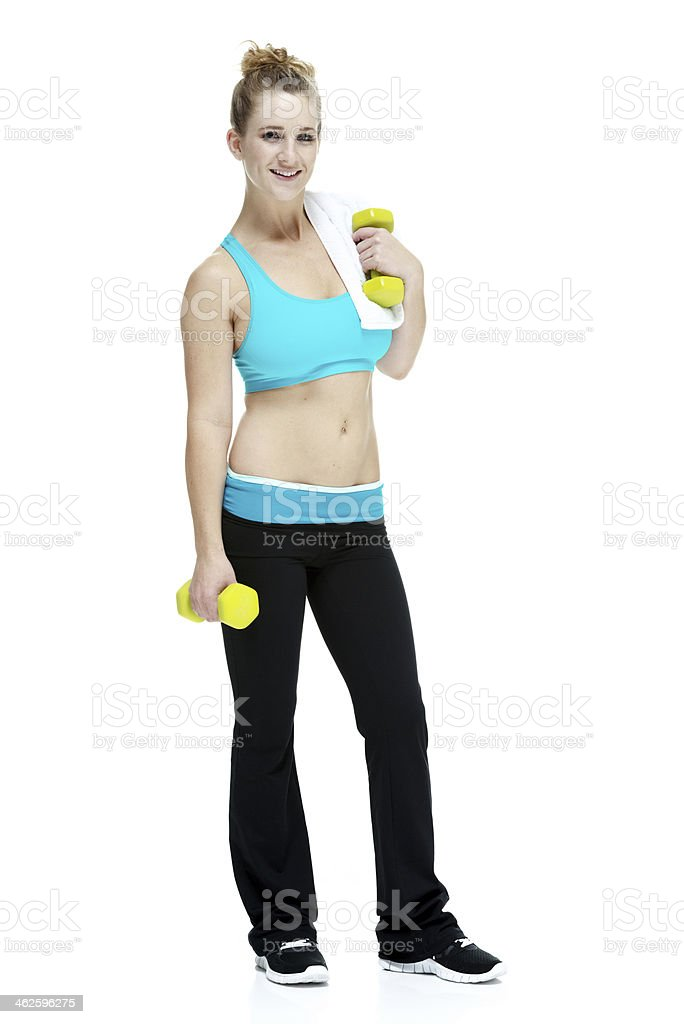 Happy young woman holding dumbbell stock photo