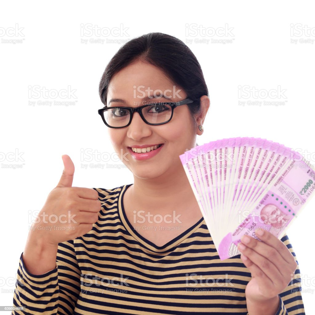 Happy young woman holding Indian 2000 rupee notes stock photo