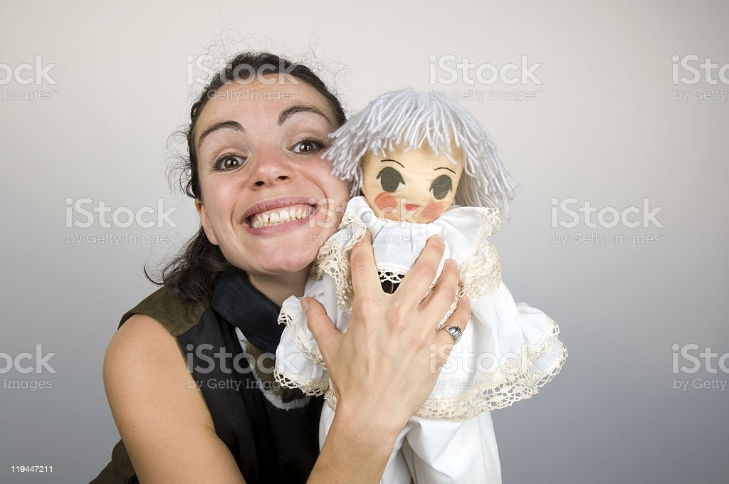 Happy Young Woman Holding Puppet royalty-free stock photo