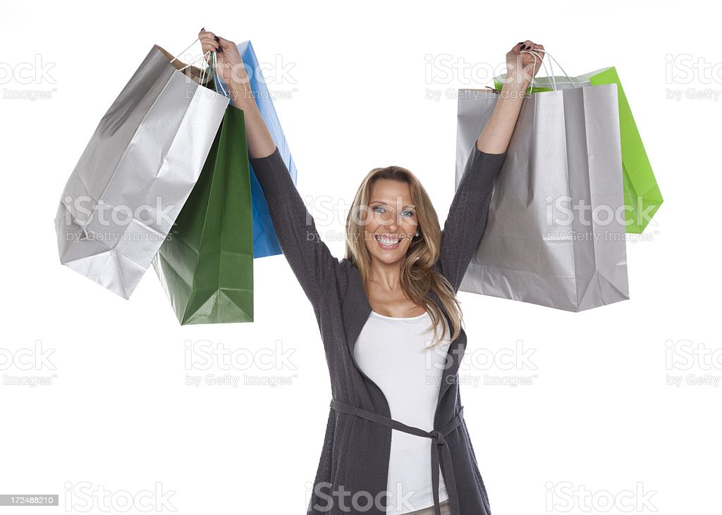Happy young woman holding several bags. royalty-free stock photo