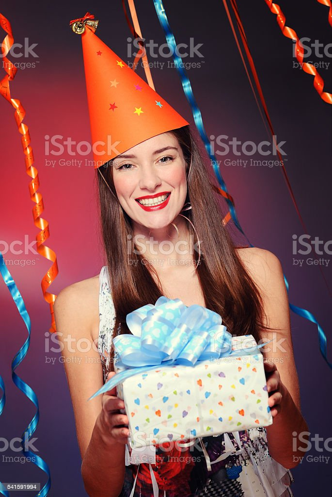 Happy young woman holding the present stock photo