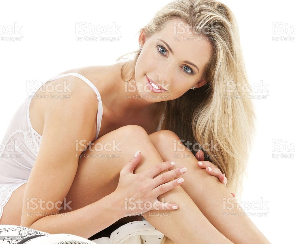 happy young woman in bed royalty-free stock photo
