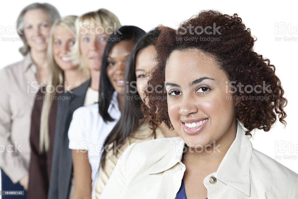 Happy young woman in front of diverse women line royalty-free stock photo
