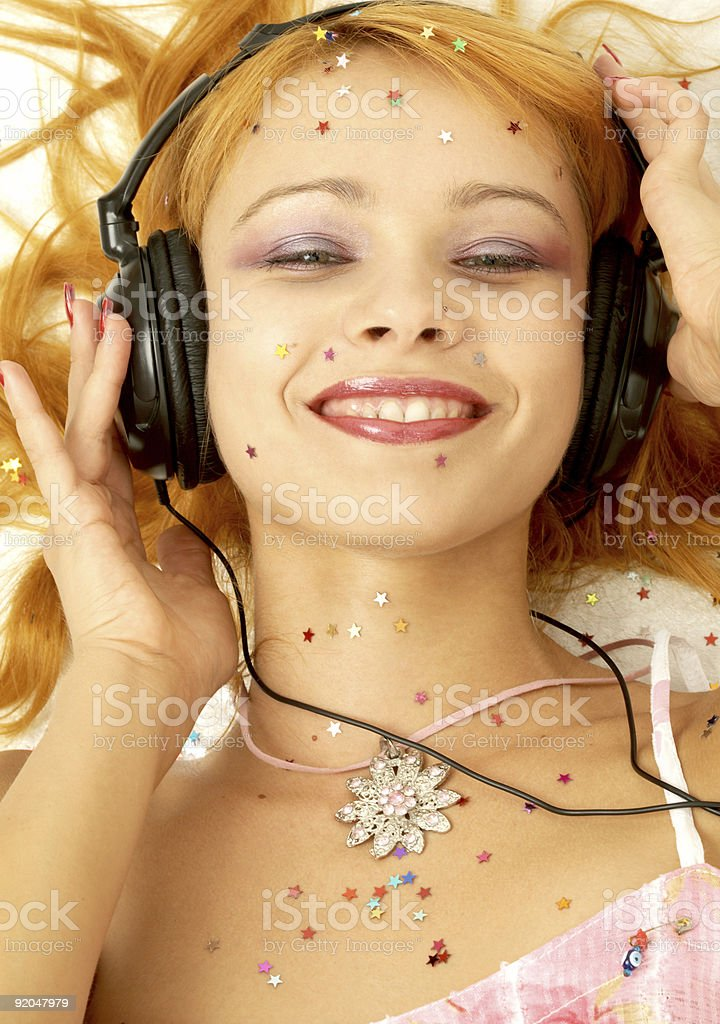 happy young woman in headphones royalty-free stock photo