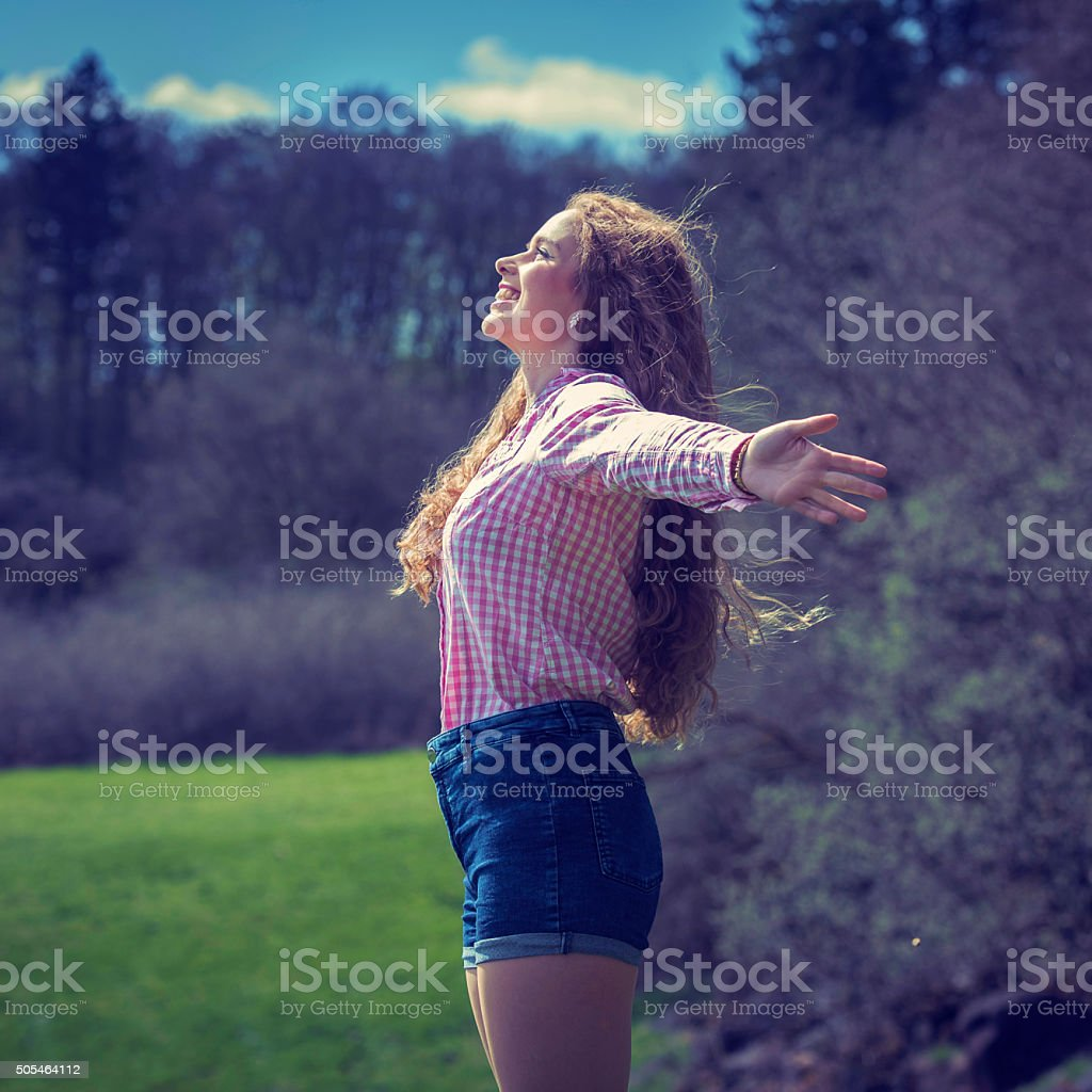 Happy young woman in nature stock photo