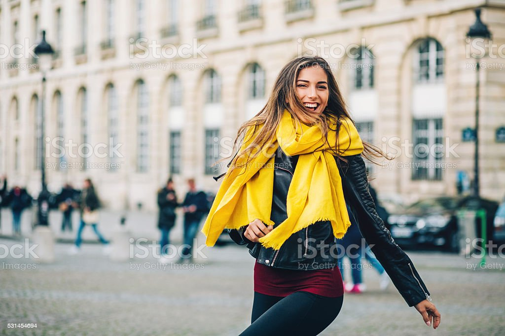 Happy young woman in Paris city stock photo