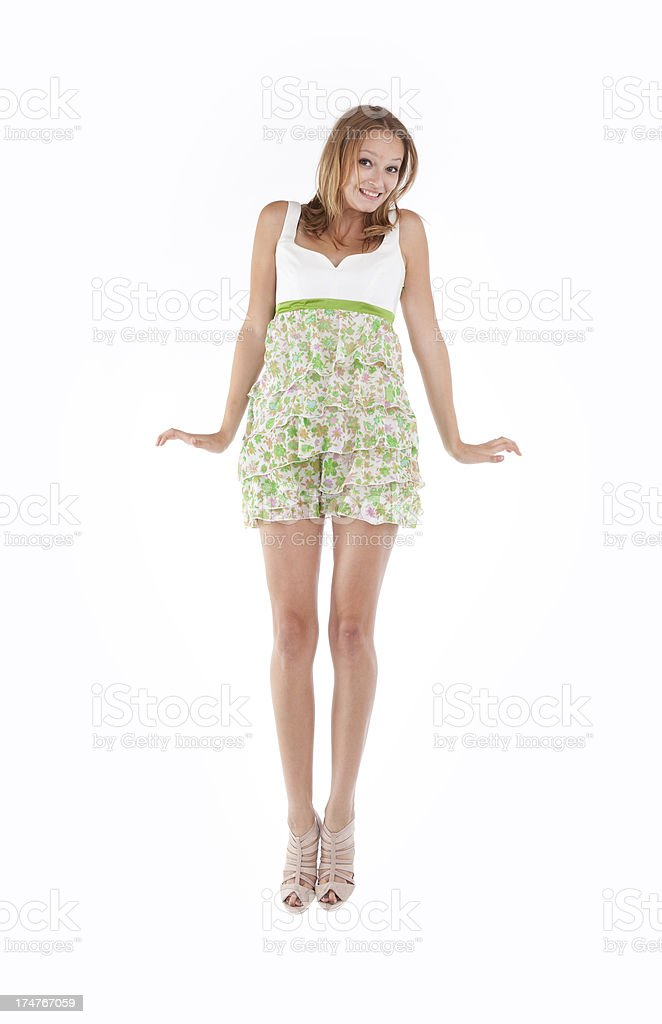 Happy young woman jumping in joy royalty-free stock photo