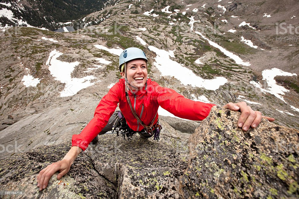 Happy young woman leading a climbing route in Colorado royalty-free stock photo