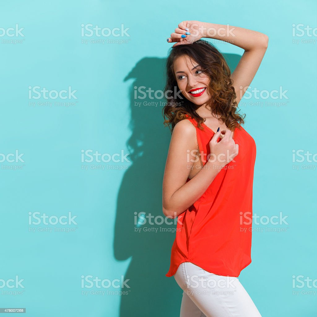 Happy Young Woman Looking Back stock photo