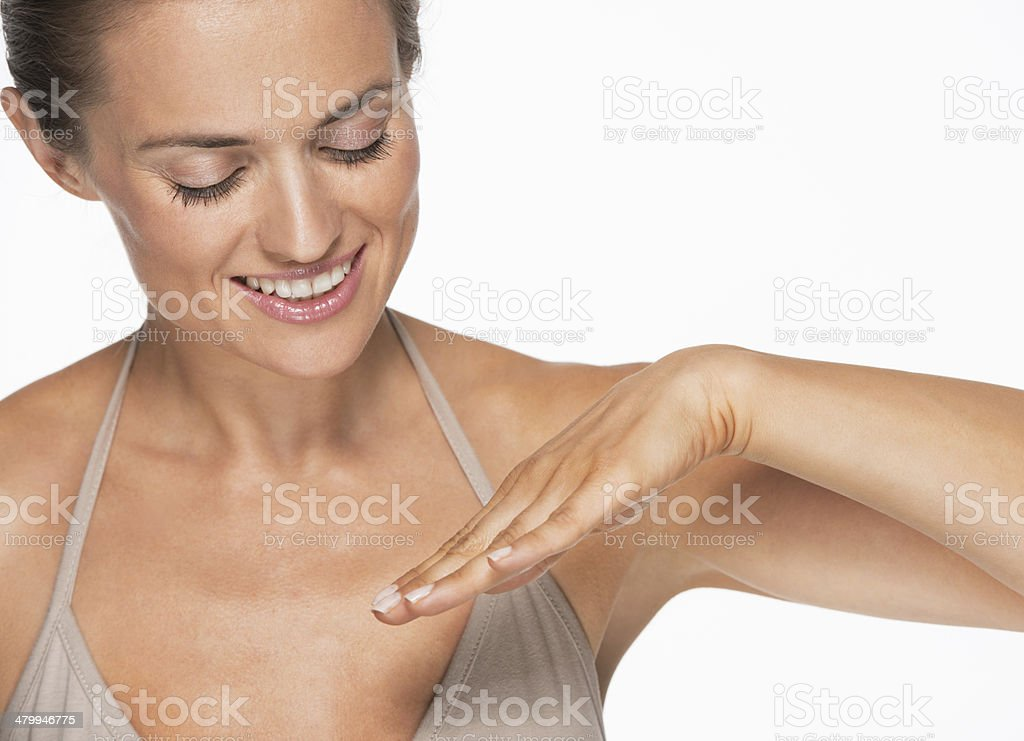 happy young woman looking on nails stock photo