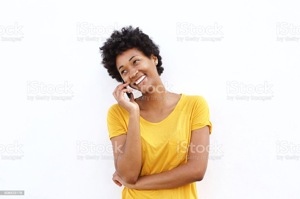 Happy young woman making a phone call stock photo