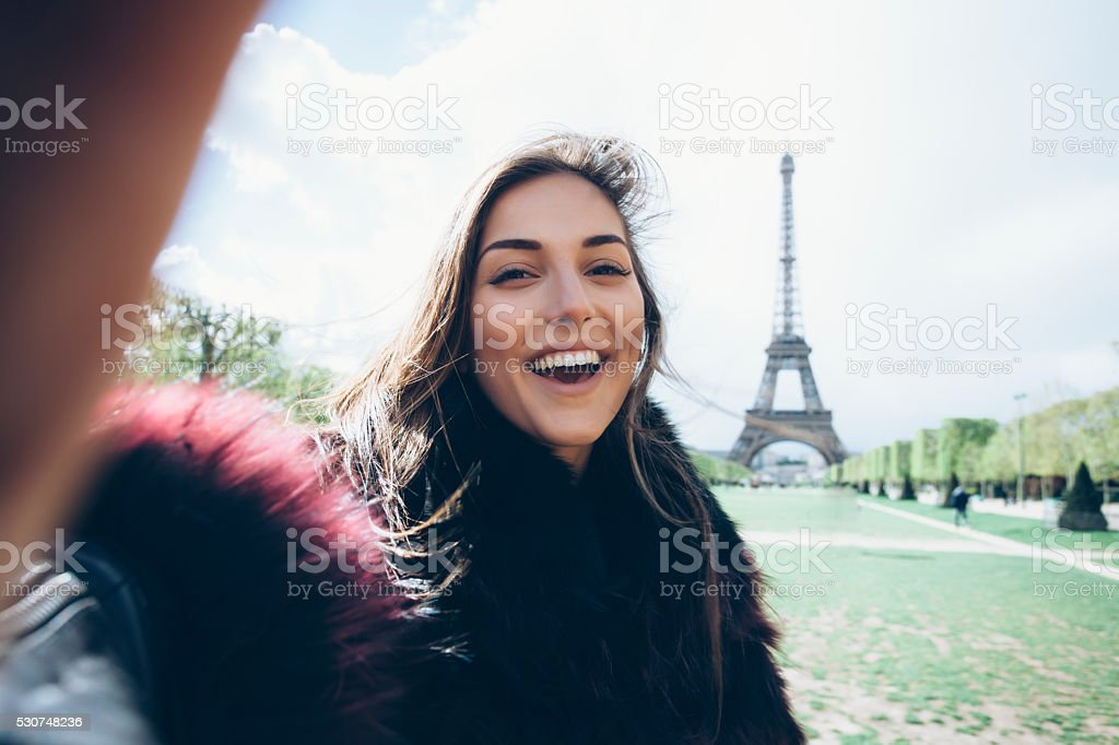 Happy young woman making selfie stock photo