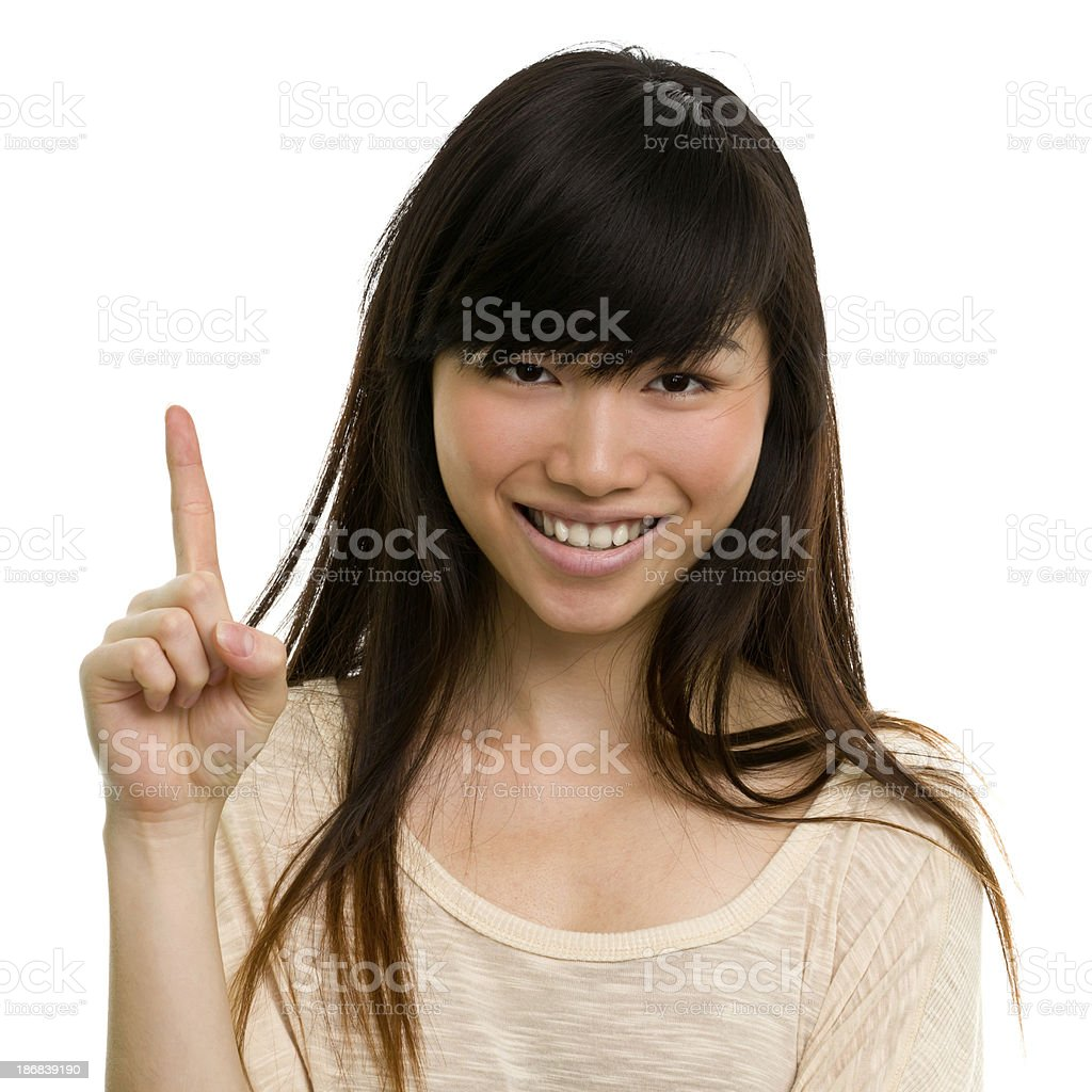 Happy Young Woman Number One Finger Gesture stock photo