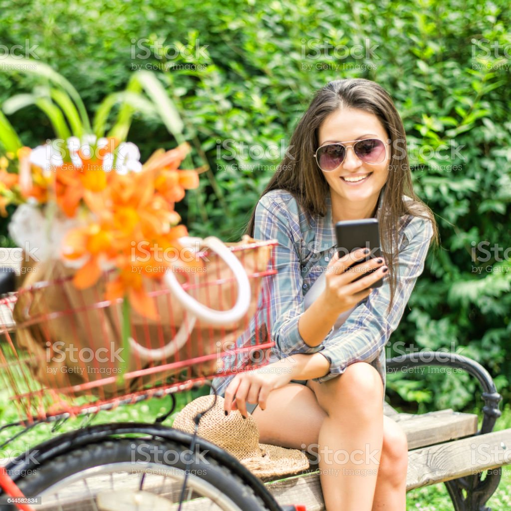Happy young woman on phone stock photo