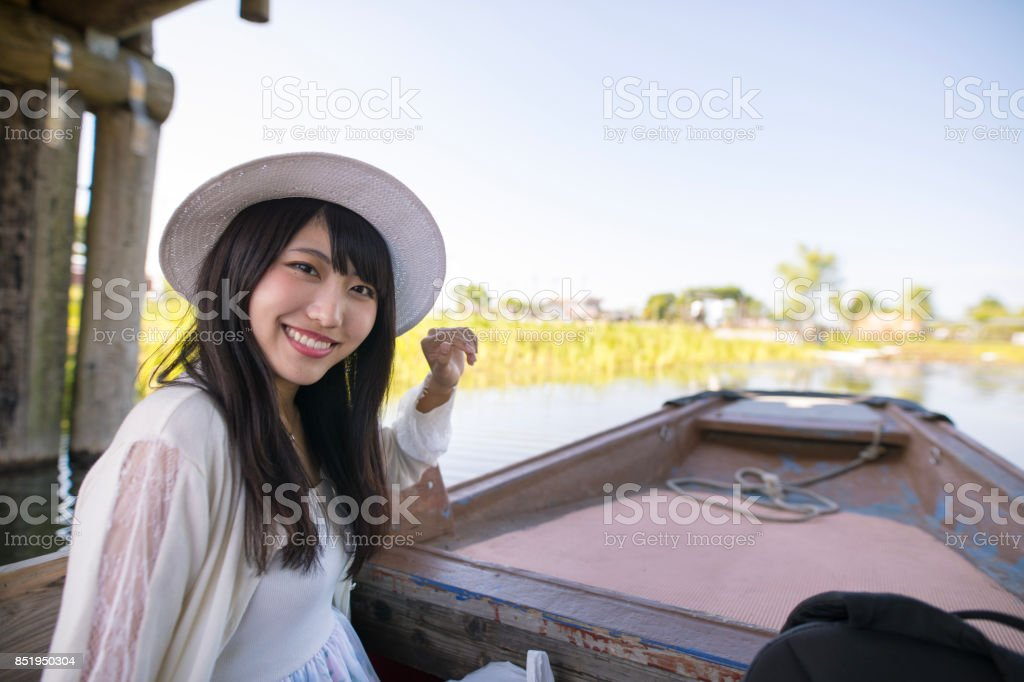 Happy young woman on sightseeing boat stock photo