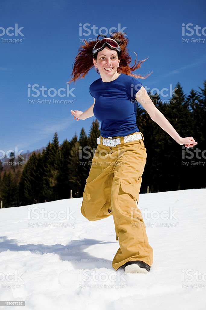 Happy young woman on snow royalty-free stock photo
