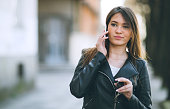 Happy young woman on the Phone