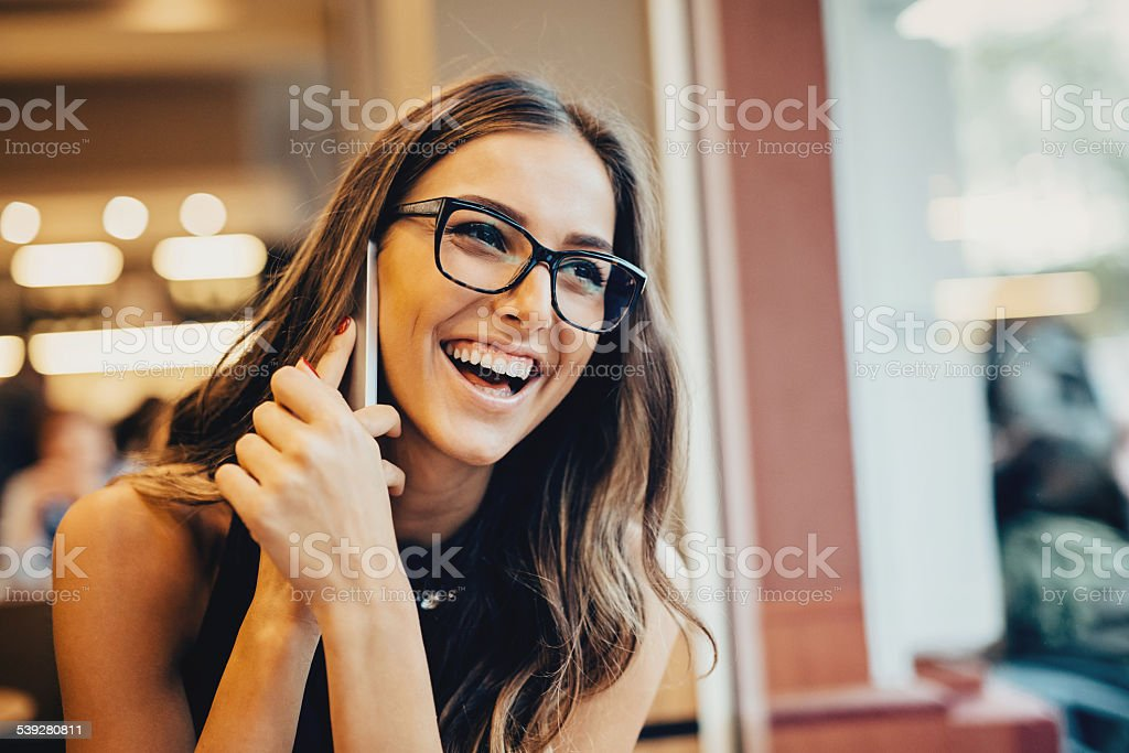 Happy young woman on the Phone stock photo