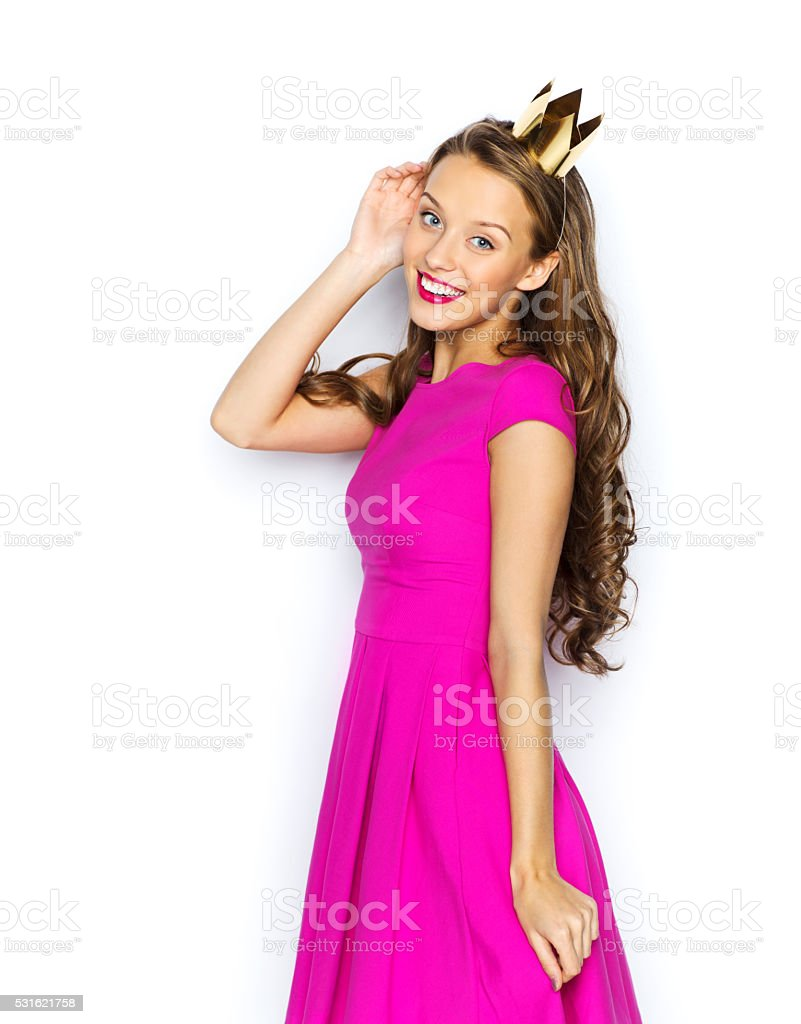 happy young woman or teen girl in princess crown stock photo