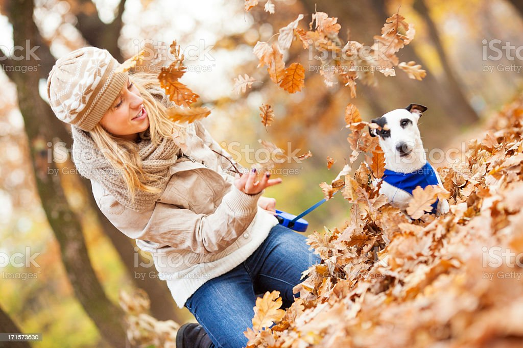 Happy Young Woman Playing With her dog outdoors. royalty-free stock photo
