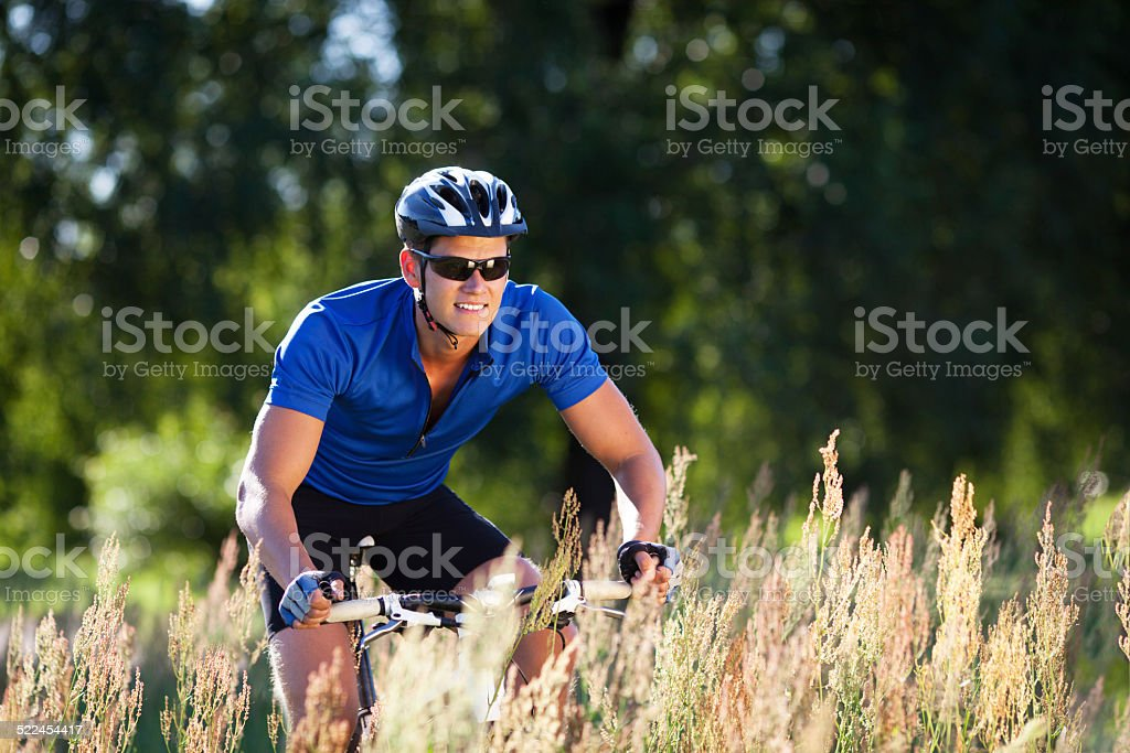 Happy Young Woman riding bicycle outside. Healthy Lifestyle. stock photo
