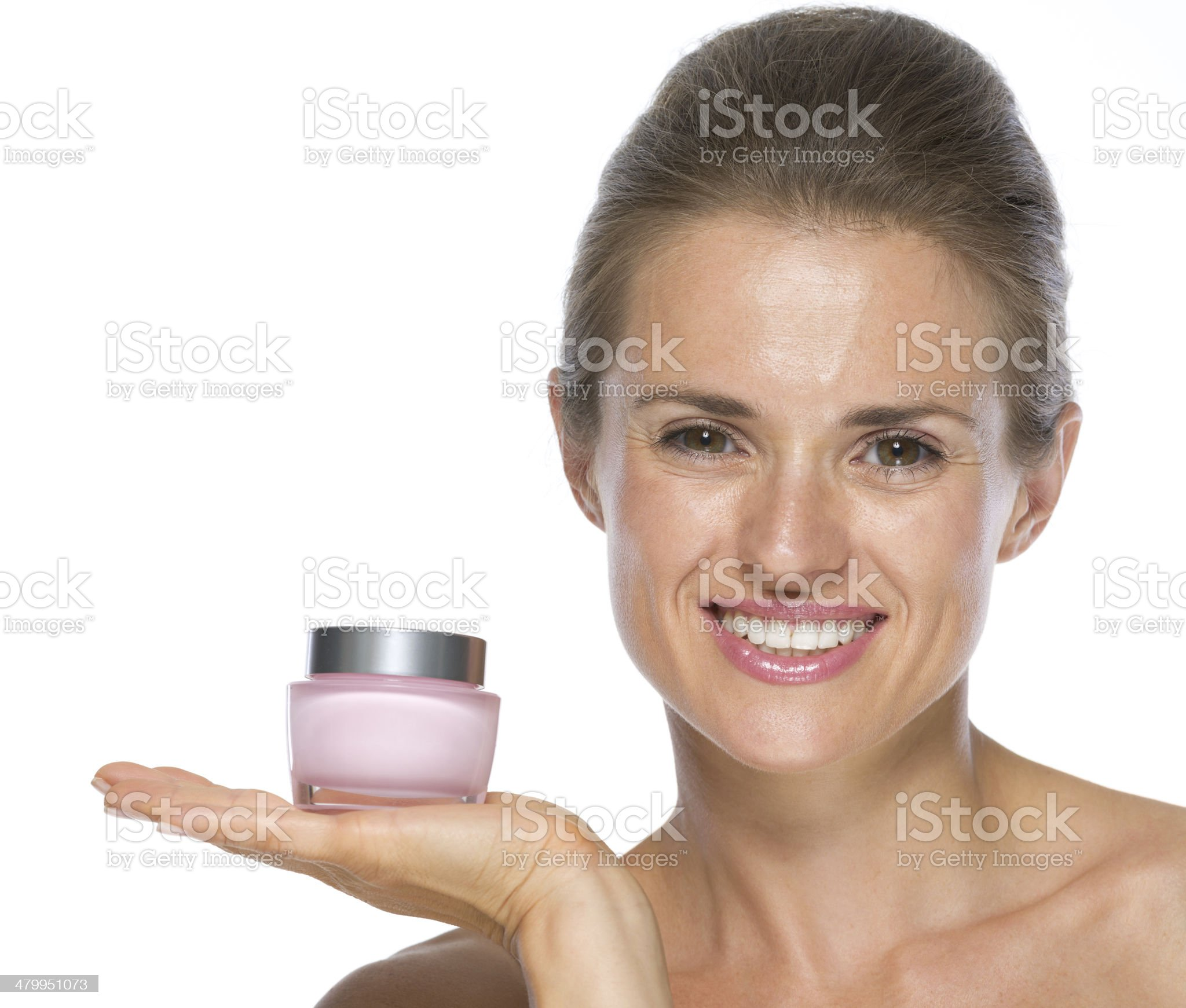 happy young woman showing cream bottle royalty-free stock photo