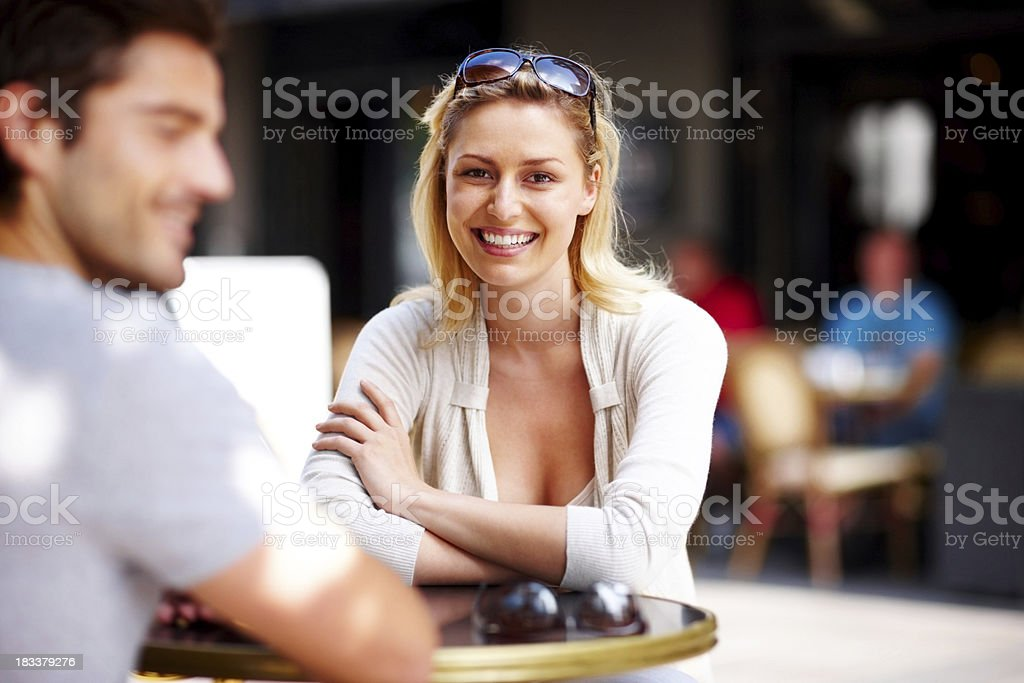 Happy young woman sitting with her boyfriend royalty-free stock photo