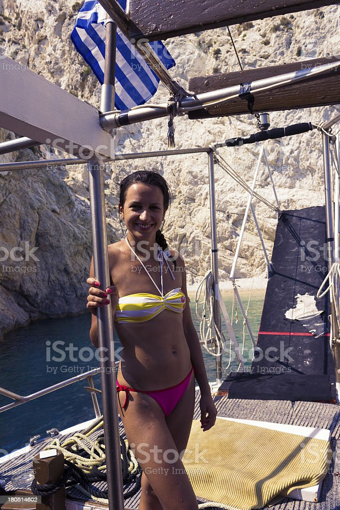 Happy young woman standing on yacht royalty-free stock photo