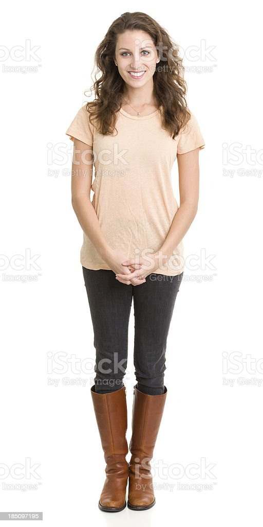 Happy Young Woman Standing With Hands Clasped stock photo