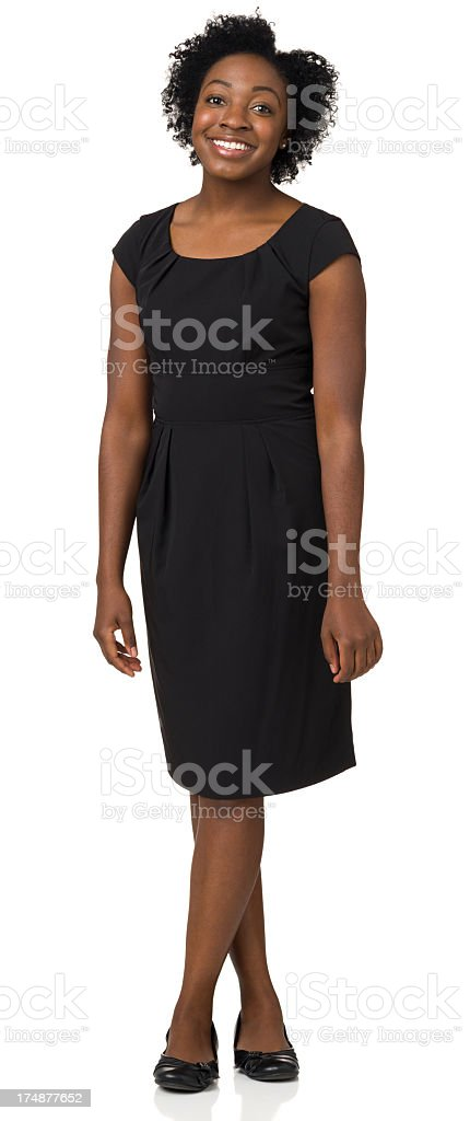 Happy Young Woman Standing With Legs Crossed royalty-free stock photo