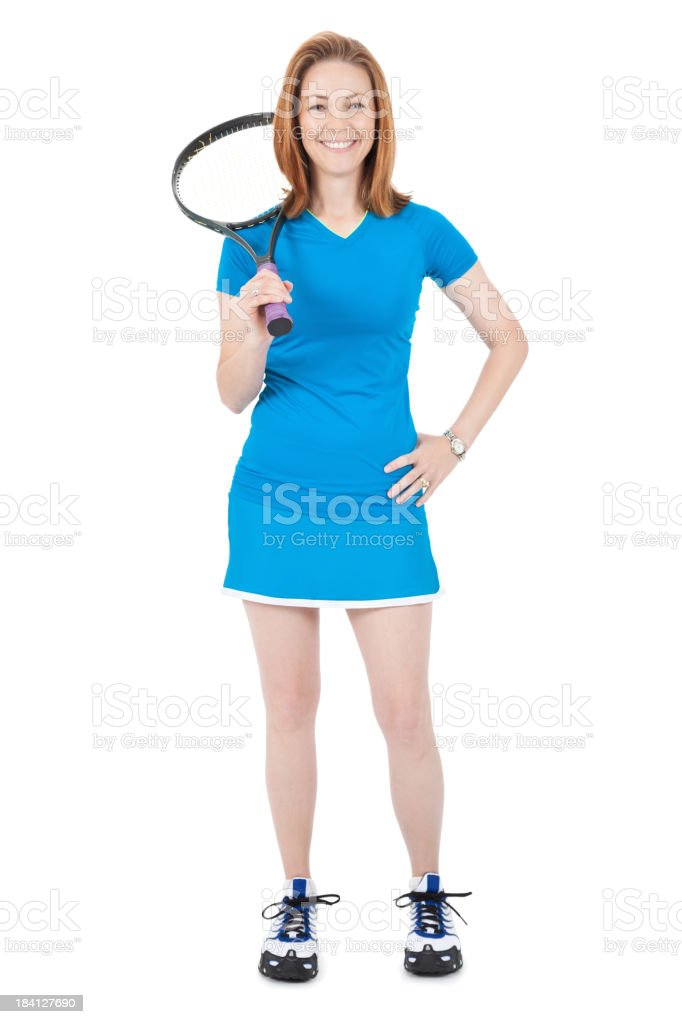 Happy Young Woman Standing With Tennis Racket On Shoulder stock photo