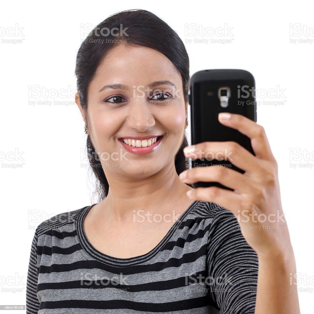 Happy young woman taking a selfie stock photo