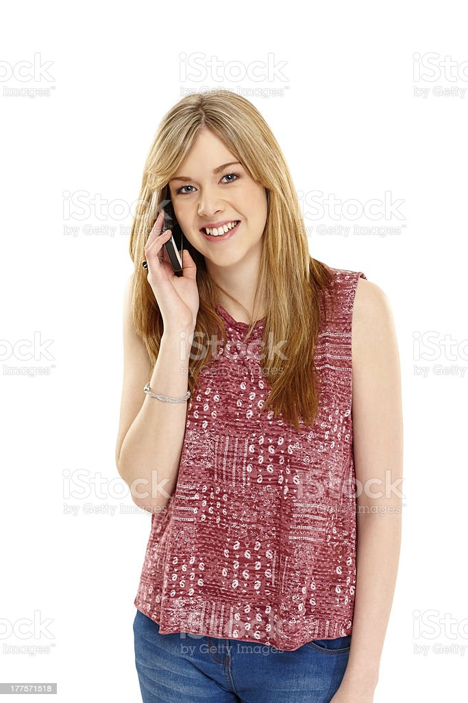 Happy young woman talking on mobile phone royalty-free stock photo