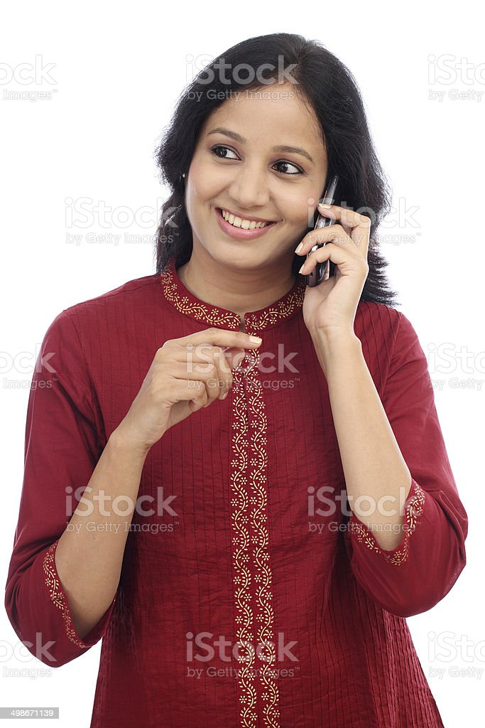 Happy young woman talking on mobile phone stock photo