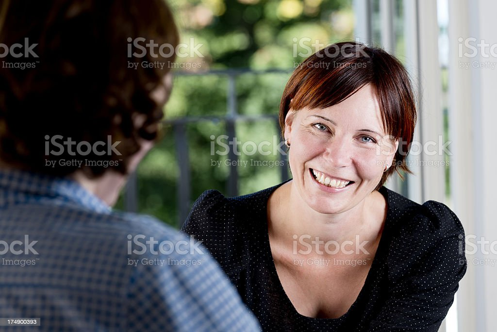 Happy Young Woman Talking To a Colleague. royalty-free stock photo