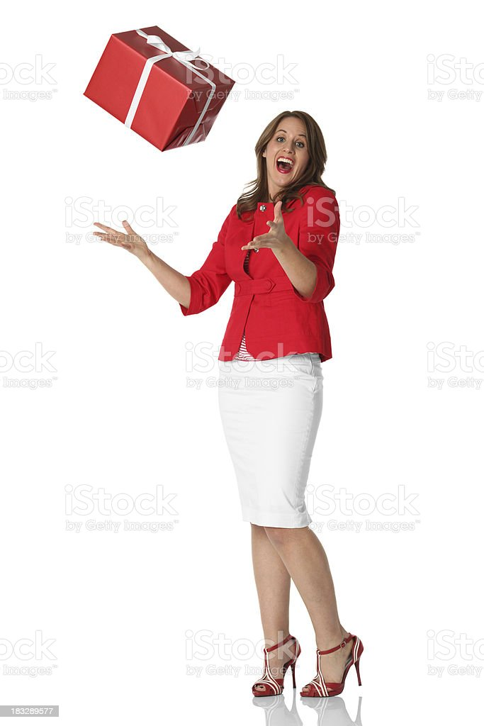 Happy young woman tossing up a present royalty-free stock photo