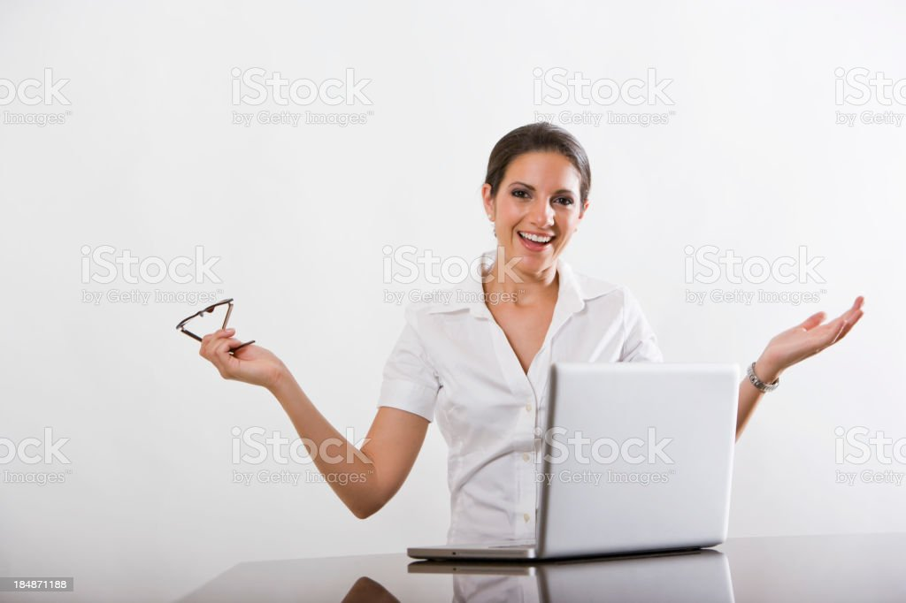 Happy young woman using laptop computer royalty-free stock photo