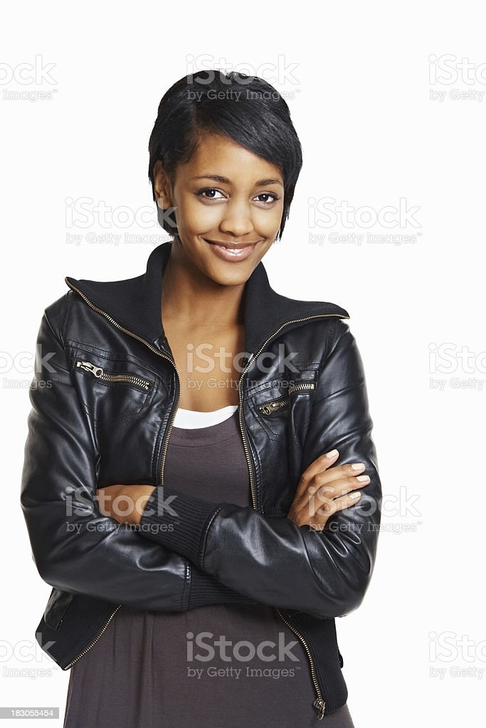 Happy young woman wearing black leather jacket with hands folded royalty-free stock photo
