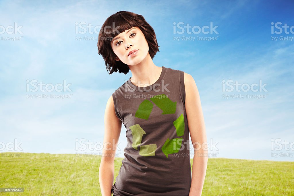 Happy young woman wearing recycle t-shirt in nature royalty-free stock photo