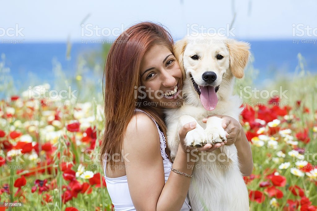 Happy young woman with a dog royalty-free stock photo