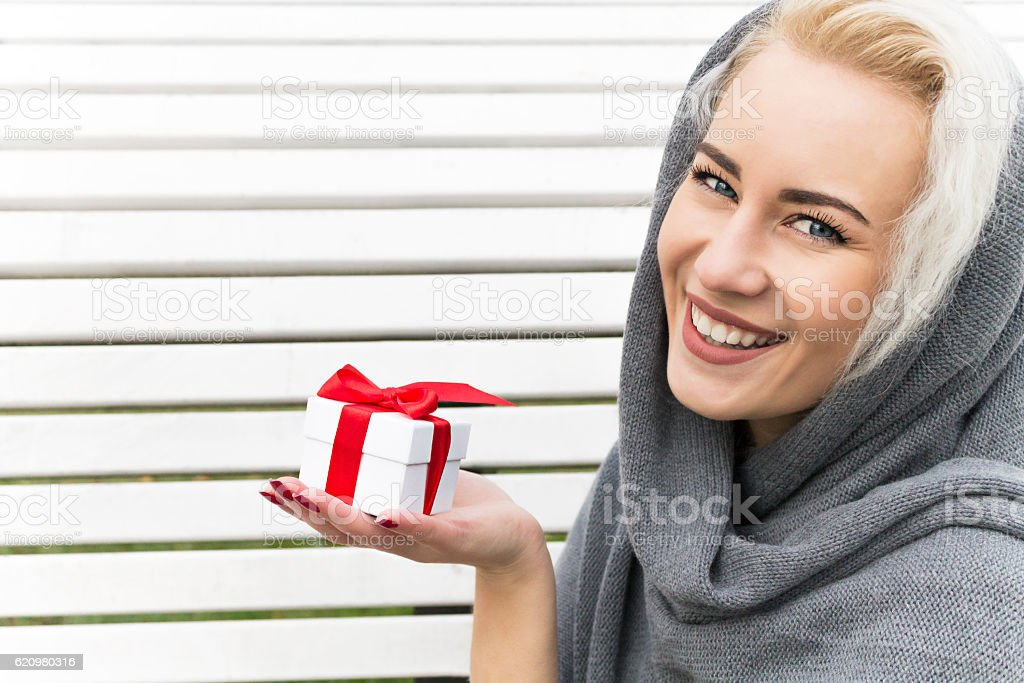 Happy Young Woman with a Gift. Winter Concept. stock photo